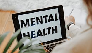 Mental Health written on a laptop screen. Image by Polina Zimmerman