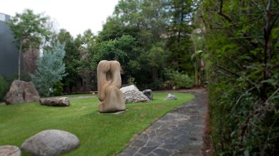 Jan Shaw, Close Encounter, Gosford sandstone sculpture