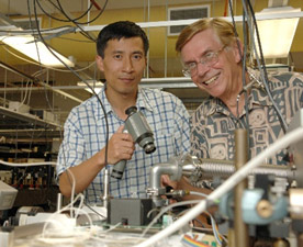 Yabai He and Brian Orr preparing to align an infrared laser beam