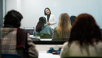 A teacher talking to a class