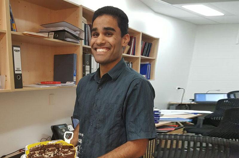 Ashwin holding his cake