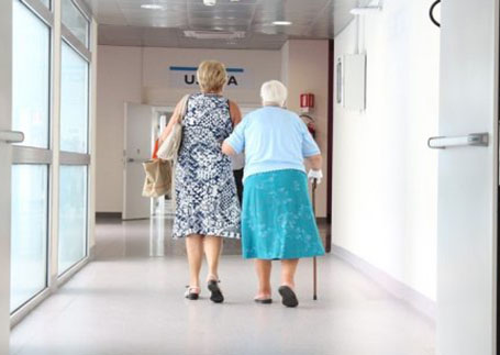 An old lady walking with another woman