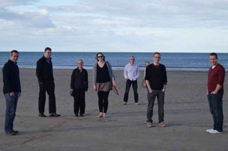 The Macgregor and Messerle group members on the beach