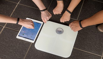 Photo of Fitbit and weight scale