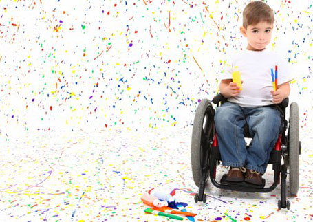 A boy in a wheelchair painting