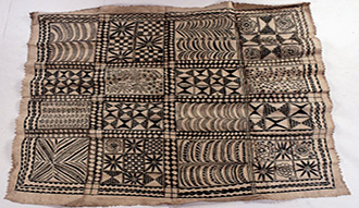 Decorated barkcloth, roughly rectangular, with serrated edges, painted with dark brown vegetable dye with flower and plant motifs within a grid pattern divided into four bands. 1892. Collection of the British Museum.