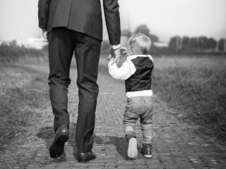 Father and son walking together. Photo by Sabine Van Straaten on Unsplash