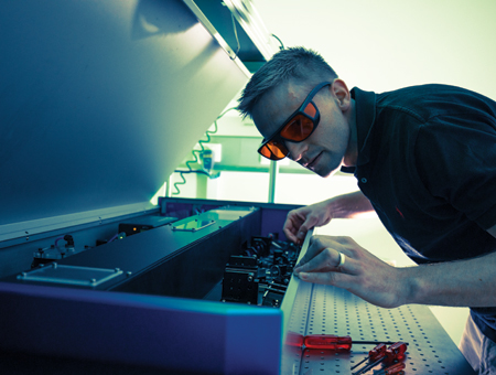 A student working on machinery