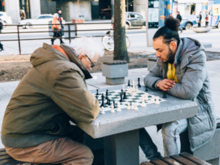 Men playing chess. Photo by Photo by AP x 90 on Unsplash