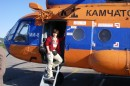 Dr Elena Belousova boarding a helicopter. Photo credit: Professor Yuri Kostitsyn