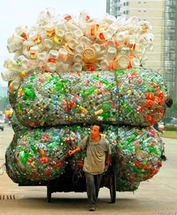 Man with many plastic bottles